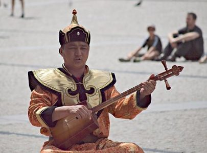 Tuvan musician playing a doshpuluur, a Turkic lute