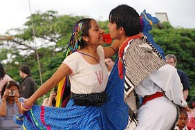 Mestizo couple dancing to a jarabe, one of the most traditional song forms of the mariachi genre.